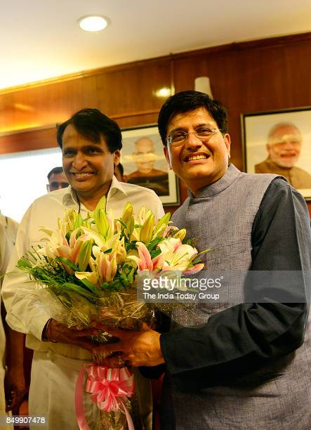 Outgoing Railway Minister Suresh Prabhu greets new Railway Minister Piyush Goyal at Rail Bhawan in New Delhi