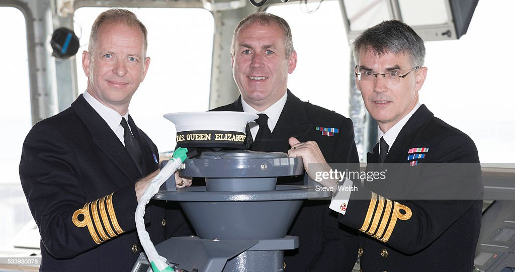 Outgoing Senior Naval Officer, Captain Simon Petitt (C) poses with the first seagoing Captain of HMS Queen Elizabeth, Captain Jerry Kyd (L) and the new Senior Naval Officer of HMS Prince of Wales, Captain Ian Groom (R) on the Bridge of the Royal Navy's new aircraft carrier HMS Queen Elizabeth on May 24, 2016 in Rosyth, United Kingdom. HMS Queen Elizabeth and HMS Prince of Wales are currently being built in Rosyth for the Royal Navy.