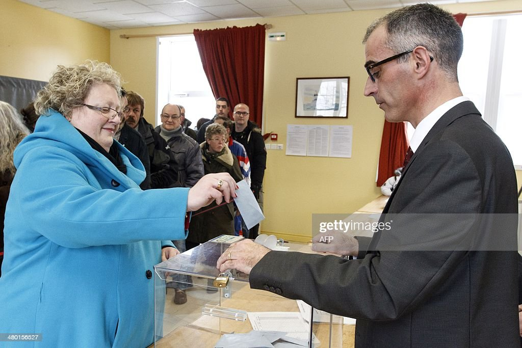 Outgoing Socialist Party mayor of SaintPierre Karine Claireaux casts her ballot in the first round of the French municipal elections on March 23 2014...