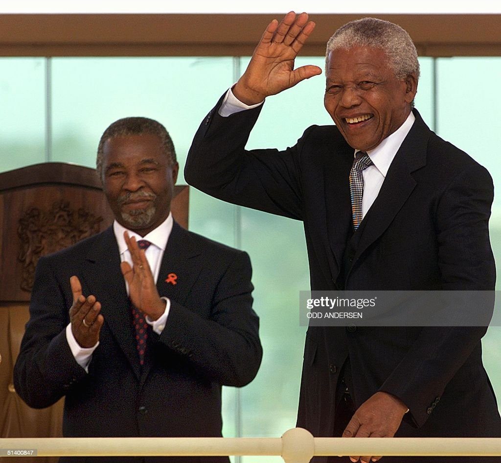 Outgoing South African President <a gi-track='captionPersonalityLinkClicked' href=/galleries/search?phrase=Nelson+Mandela&family=editorial&specificpeople=118613 ng-click='$event.stopPropagation()'>Nelson Mandela</a> (R) waves as he arrives for the inauguration of <a gi-track='captionPersonalityLinkClicked' href=/galleries/search?phrase=Thabo+Mbeki&family=editorial&specificpeople=160910 ng-click='$event.stopPropagation()'>Thabo Mbeki</a> (R) as second democratically elected President of the Republic of South Africa at the Union Buildings in Pretoria, 16 June 1999.