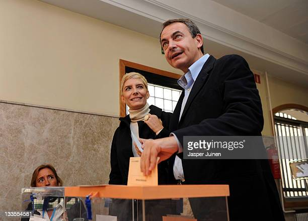 Outgoing Spanish prime minister Jose Luis Rodriguez Zapatero of the Socialist Party casts his ballot for the Spanish general elections beside his...