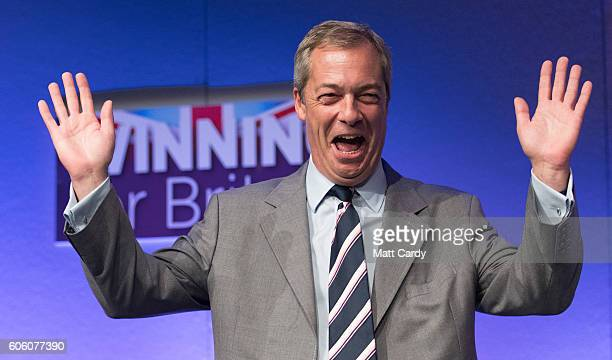 Outgoing UKIP leader Nigel Farage prepares to congratulate MEP Diane James after she was announced as the new leader of UKIP at the Bournemouth BIC...