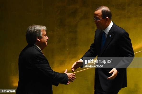 TOPSHOT Outgoing UN Secretary General Ban Kimoon shakes hand with SecretaryGeneraldesignate Antonio Guterres during the ceremony for the appointment...