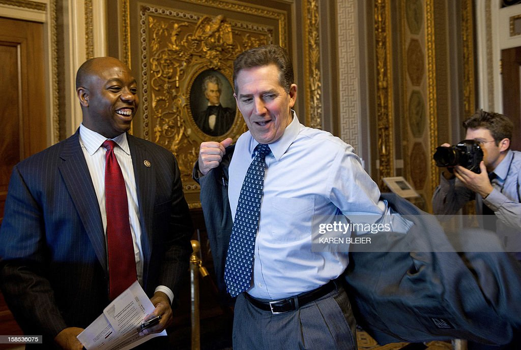 Outgoing US Republican Senator from South Carolina Jim DeMint (C) and Republican Representative from South Carolina <a gi-track='captionPersonalityLinkClicked' href=/galleries/search?phrase=Tim+Scott+-+Politicus&family=editorial&specificpeople=12898323 ng-click='$event.stopPropagation()'>Tim Scott</a> (L) emerge form meetings on December 18, 2012 on Capitol Hill in Washington. Republican Gov. Nikki Haley of South Carolina announced on December 17 that she's appointing Scott as DeMint's successor following his resignation to head the conservative Heritage Foundation thinktank. AFP PHOTO/Karen BLEIER