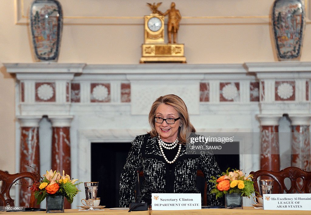 Outgoing US Secretary of State Hillary Clinton takes her seat as she hosts the announcement of the Open Book Project at the State Department in Washington, DC, on January 28, 2013. The Open Book Project is an initiative of the US Department of State, the Arab League Educational, Cultural and Scientific Organization and leading education innovators to expand access to free, high-quality open educational resources in Arabic, with a focus on science and technology and online learning. AFP PHOTO/Jewel Samad