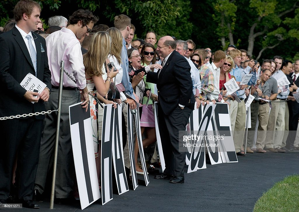 Outgoing US White House Deputy Chief of Staff Joe Hagin greets a wellwisher who came to bid him farewell as he arrived aboard presidential helicopter Marine One on the South Lawn of the White House with US President George W. Bush and First Lady Laura Bush in Washington on July 20, 2008. Bush spent the weekend at his ranch in Crawford, Texas. AFP PHOTO/Nicholas KAMM