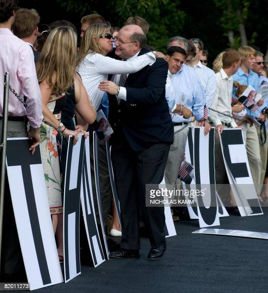 Outgoing US White House Deputy Chief of Staff Joe Hagin greets a wellwisher who came to bid him farewell as he arrived aboard presidential helicopter...