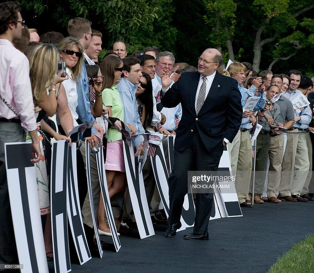 Outgoing US White House Deputy Chief of Staff Joe Hagin greets wellwishers who came to bid him farewell as he arrived aboard presidential helicopter Marine One on the South Lawn of the White House with US President George W. Bush and First Lady Laura Bush in Washington on July 20, 2008. Bush spent the weekend at his ranch in Crawford, Texas. AFP PHOTO/Nicholas KAMM