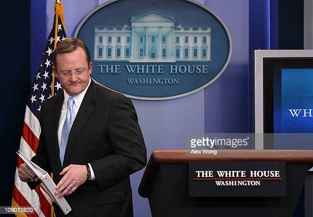 Outgoing White House Press Secretary Robert Gibbs leaves after his last daily press briefing February 11 2011 at the White House in Washington DC...