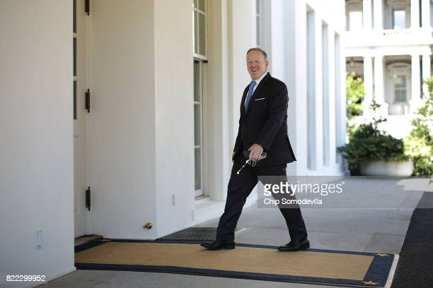 Outgoing White House Press Secretary Sean Spicer returns to the White House after participating in 'Regional Media Day' July 25 2017 in Washington DC...