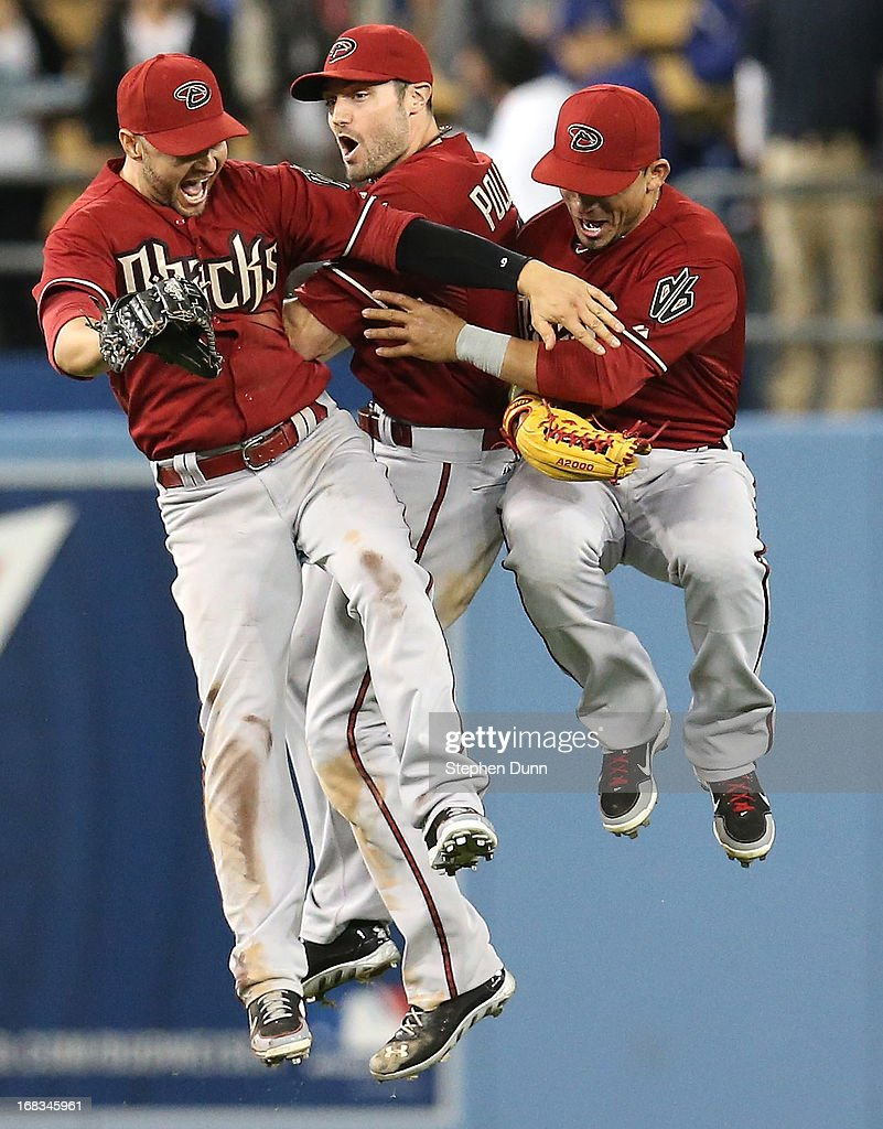 Outifielders Cody Ross #7, A.J. Pollock #11, and Gelrardo Parra #8 (L to R) of the Arizona Diamondbacks jump together to celebrate after the game against the Los Angeles Dodgers at Dodger Stadium on May 8, 2013 in Los Angeles, California. The Diamondbacks won 3-2.