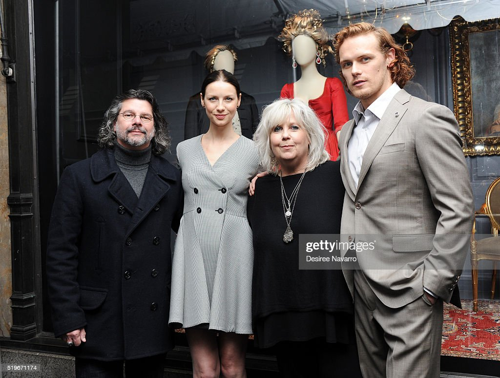 'Outlander' Executive Producer Ronald D. Moore, actress Caitriona Balfe, 'Outlander' Costume Designer Terry Dresbach and actor Sam Heughan attend Saks Fifth Avenue 'Outlander' Window Display Unveiling at Saks Fifth Avenue on April 7, 2016 in New York City.