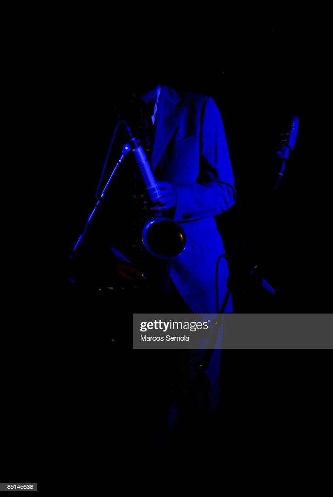Outline of a saxophone musician playing : Stock Photo