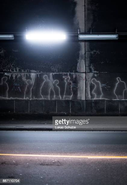 Outlines of visitors of the Love Parade 2010 are seen in a tunnel near by the memorial to the 2010 Love Parade disaster on December 6 2017 in...