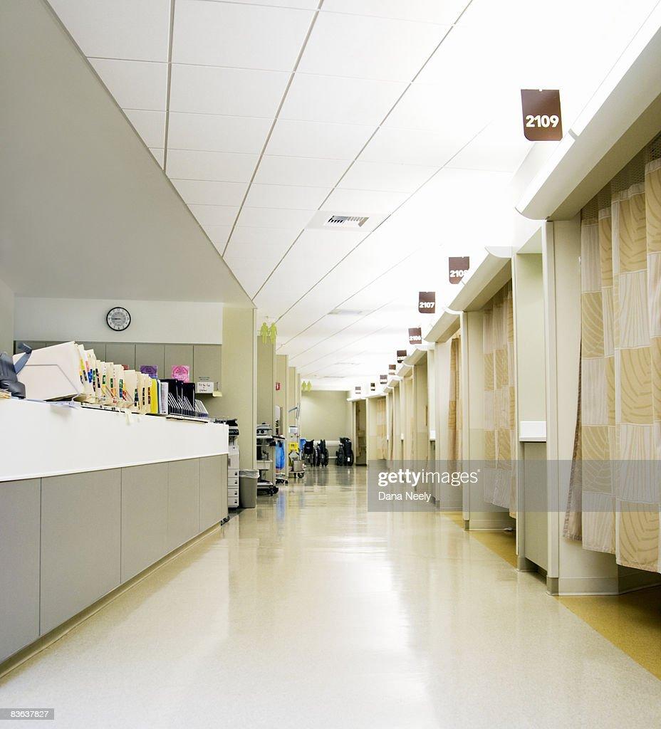 Outpatient desk & empty hospital corridor