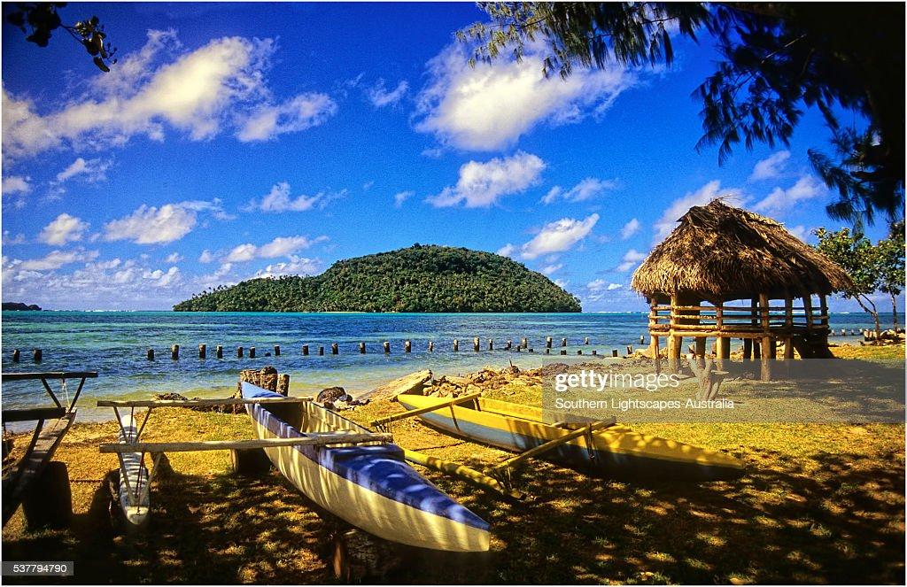 Outrigger canoe and Coastline on The Island of Upolu, Western Samoa.