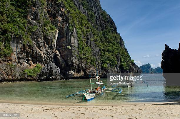 EL NIDO PALAWAN PHILIPPINES Outrigger canoes at one of the many islands of El Nido archipelago El Nido is considered as a showcase of Palawan's...