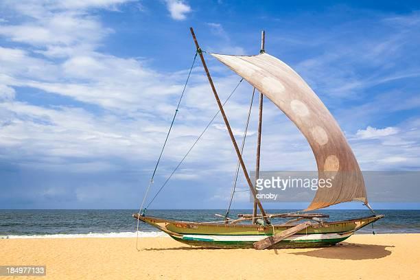 Outrigger Prahu or Proa on the Beach in Sri Lanka