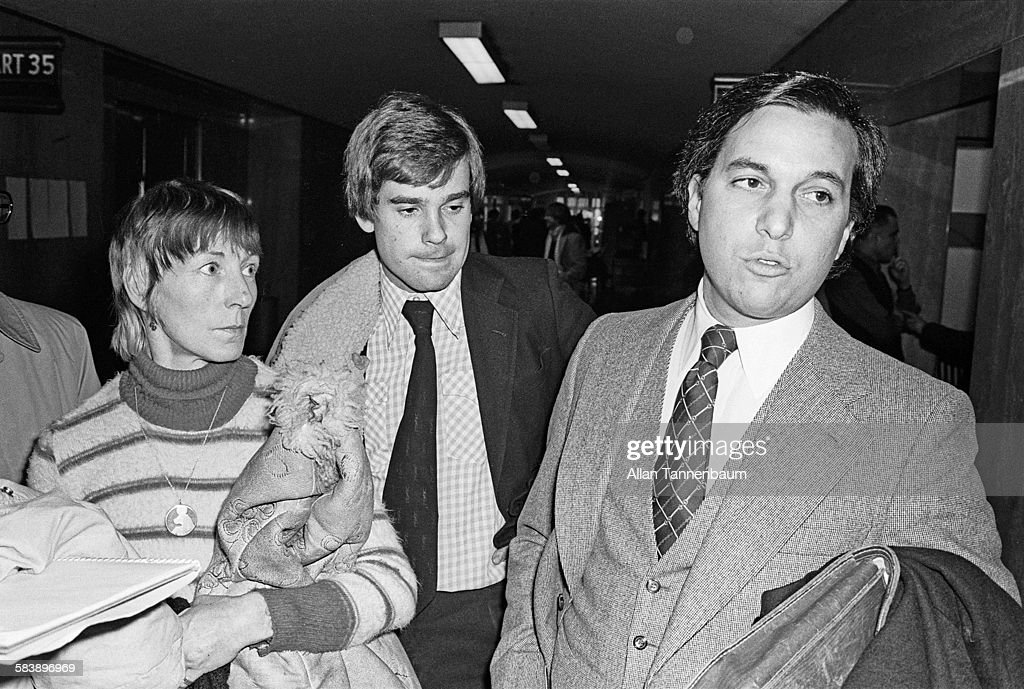 Outside a court room, Sid Vicious' mother Ann Beverly (left) stands with attorney James Merberg (right) for her son's bail hearing on the Nancy Spungen murder charge, New York, New York, January 16, 1979.
