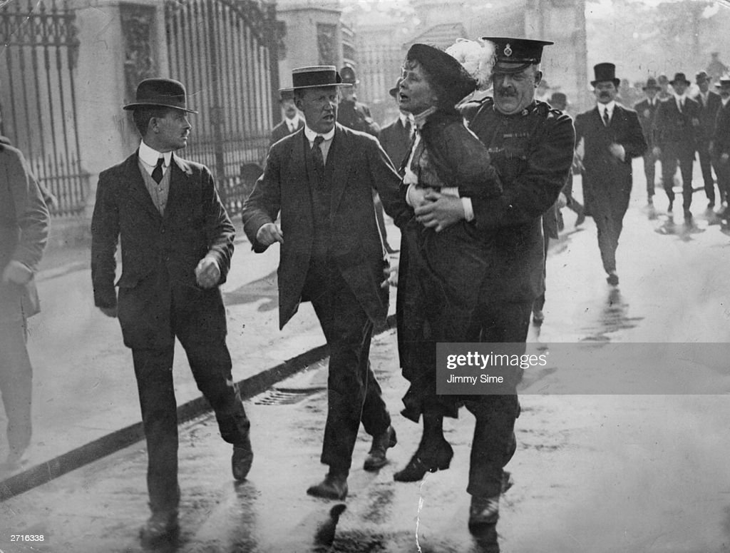 Outside Buckingham Palace, English suffragette Emmeline Pankhurst (1858 - 1928), is arrested and carried away by Superintendent Rolfe at a march, organised by Pankhurst, to petition King George V, London, 21st May 1914. On arrival at the palace, the marchers were met with force by the police and violence from the crowd of onlookers.