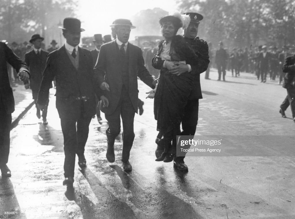 English suffragette Emmeline Pankhurst (1858 - 1928), founder with her daughter Christabel (1880 - 1958), of the Women's Social and Political Union in 1903, being removed from a Suffragette protest by a policeman. She was frequently imprisoned and underwent hunger strikes and forcible feeding.