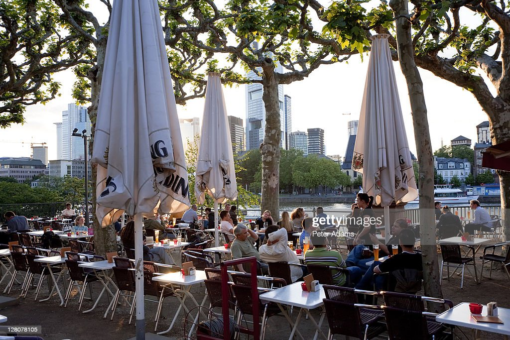 Outside cafe and beer garden, by Main River, Frankfurt, Germany