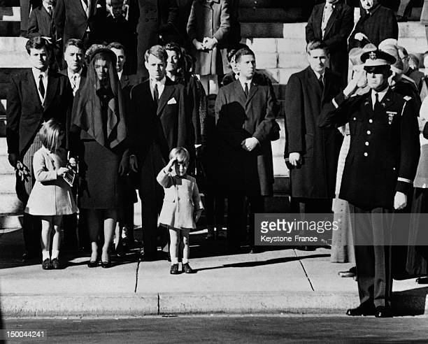 Outside Cathedral St Matthew John John Kennedy salutes his father's coffin with members of the Kennedy family From left Senator Edward Kennedy...