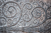 Ornament twirly metal fittings on ancient medieval door. The portal with the doors was constructed between 1210-1220, and the cathedral was restored 1845. The original creator of the artwork is unknow