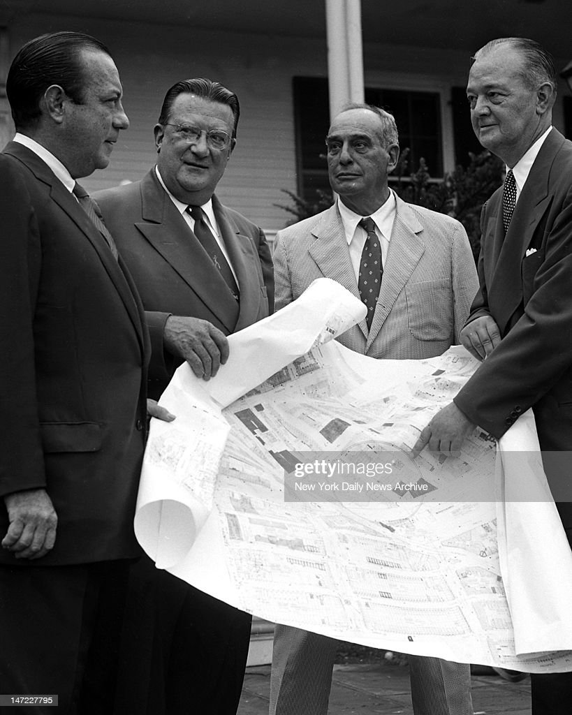 Outside Gracie Mansion Mayor Robert Wagner Walter O'Malley and Robert Moses look on as Brooklyn Borough President John Cashmore points out spot on...