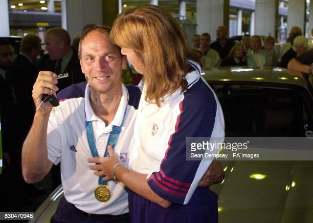 Outside Heathrow Airport rower Steve Redgrave gets given the keys to a brand new silver Jaguar XJR by his wife Ann to celebrate his recordbreaking...