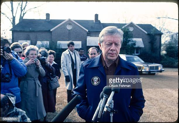 Outside his home American politician and former US President Jimmy Carter speaks to the press following his return to his hometown after leaving the...