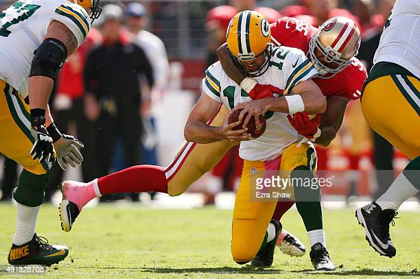 Outside linebacker Ahmad Brooks of the San Francisco 49ers sacks quarterback Aaron Rodgers of the Green Bay Packers during their NFL game at Levi's...