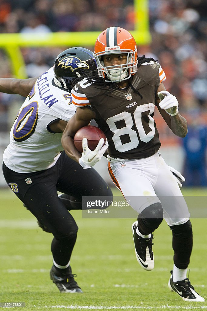Outside linebacker Albert McClellan #50 of the Baltimore Ravens tries to catch wide receiver Travis Benjamin #80 of the Cleveland Browns during the second half at Cleveland Browns Stadium on November 4, 2012 in Cleveland, Ohio. The Ravens defeated the Browns 25-15.