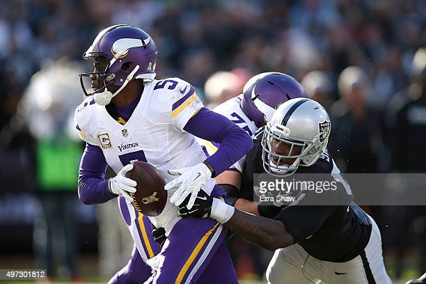 Outside linebacker Aldon Smith of the Oakland Raiders attempts the sack of quarterback Teddy Bridgewater of the Minnesota Vikings in the second...