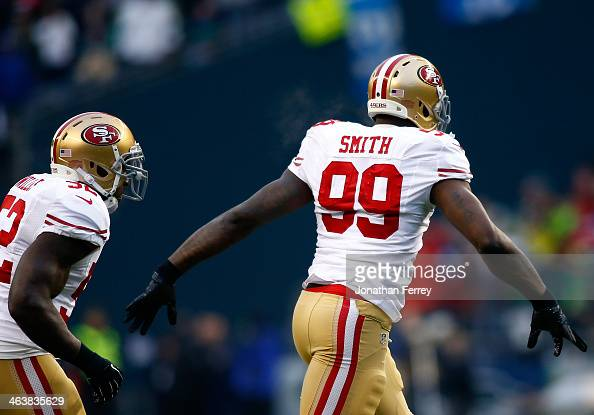 Outside linebacker Aldon Smith of the San Francisco 49ers celebrates after recovering a fumble in the first quarter against the Seattle Seahawks...
