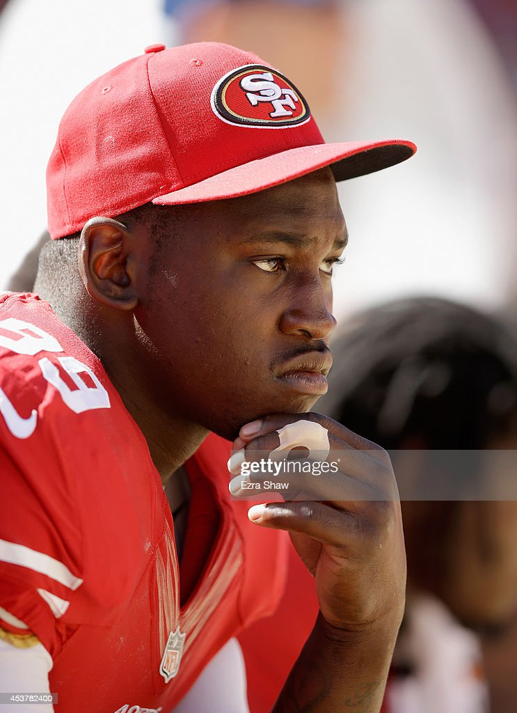 Outside linebacker Aldon Smith of the San Francisco 49ers sits on the bench during a preseason game against the Denver Broncos at Levi's Stadium on...