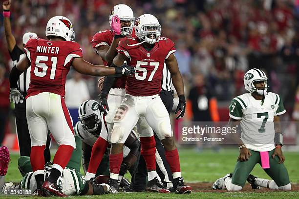 Outside linebacker Alex Okafor of the Arizona Cardinals celebrates with Kevin Minter after a sack on quarterback Geno Smith of the New York Jets...