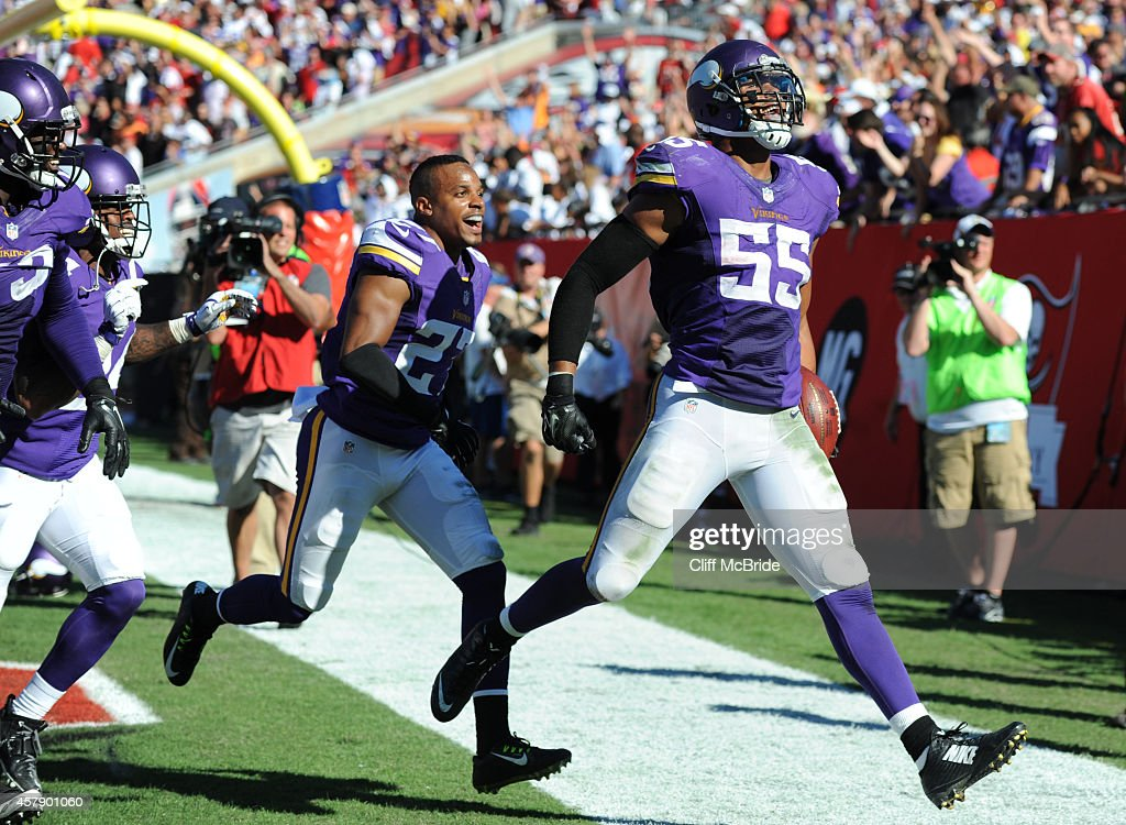 Outside linebacker Anthony Barr of the Minnesota Vikings celebrates his winning TD return with free safety Harrison Smith of the Minnesota Vikings in...