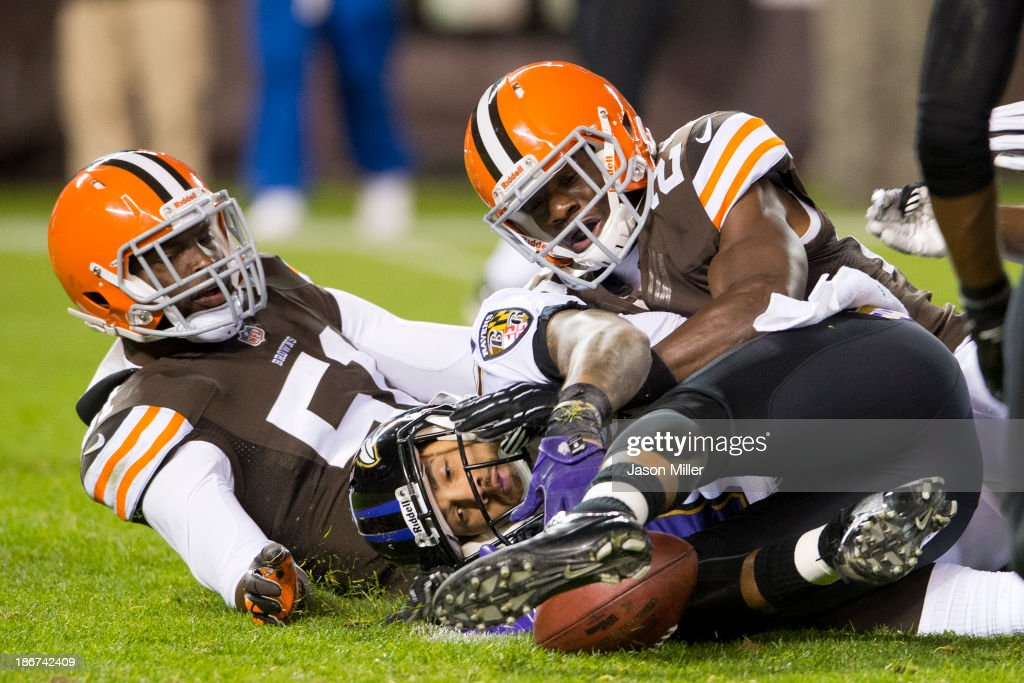 Outside linebacker Barkevious Mingo #51 of the Cleveland Browns tackles wide receiver Tandon Doss #17 of the Baltimore Ravens who fumbled a punt during the second half at FirstEnergy Stadium on November 3, 2013 in Cleveland, Ohio. The Browns defeated the Ravens 24-18.