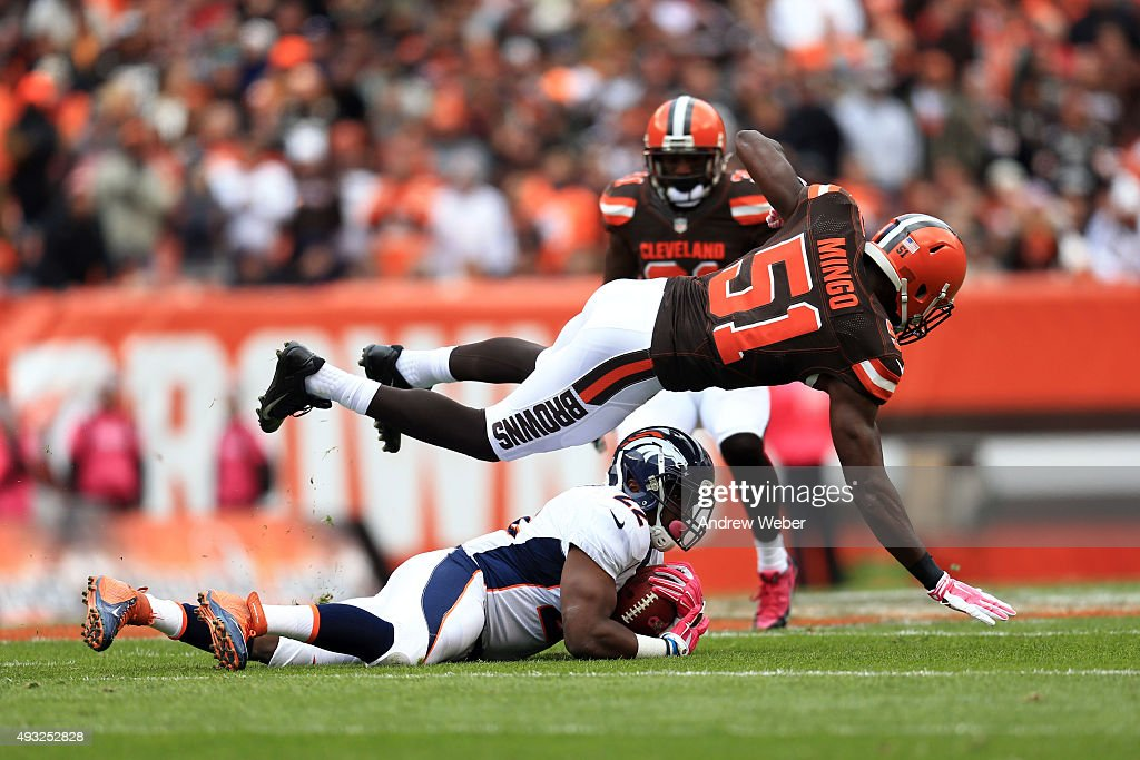 outside linebacker Barkevious Mingo of the Cleveland Browns tackles running back CJ Anderson of the Denver Broncos during the first quarter at...