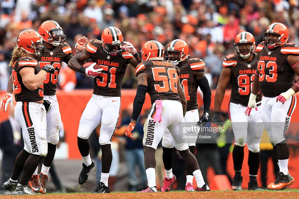 Outside linebacker Barkevious Mingo of the Cleveland Browns celebrates with teammates after a touchdown against the Denver Broncos at Cleveland...