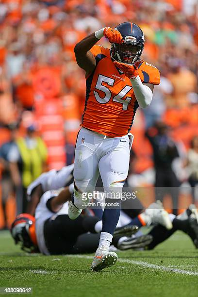 Outside linebacker Brandon Marshall of the Denver Broncos celebrates after sacking quarterback Joe Flacco of the Baltimore Ravens in the first...