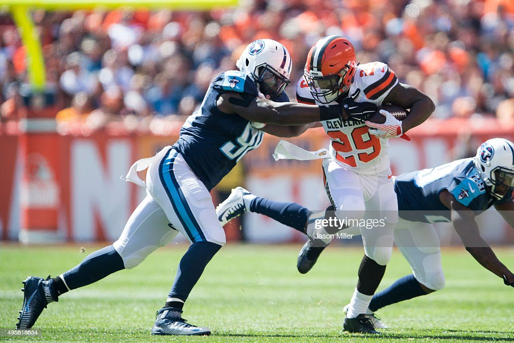 Outside linebacker <a gi-track='captionPersonalityLinkClicked' href=/galleries/search?phrase=Brian+Orakpo&family=editorial&specificpeople=2701516 ng-click='$event.stopPropagation()'>Brian Orakpo</a> #98 tackles running back <a gi-track='captionPersonalityLinkClicked' href=/galleries/search?phrase=Duke+Johnson+-+Jogador+de+futebol+americano&family=editorial&specificpeople=13981151 ng-click='$event.stopPropagation()'>Duke Johnson</a> #29 of the Cleveland Browns during the first half at FirstEnergy Stadium on September 20, 2015 in Cleveland, Ohio.