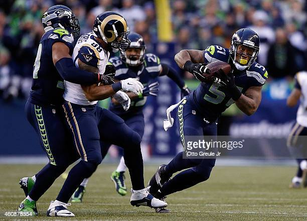 Outside linebacker Bruce Irvin of the Seattle Seahawks intercepts a pass intended for tight end Lance Kendricks of the St Louis Rams gives chase...