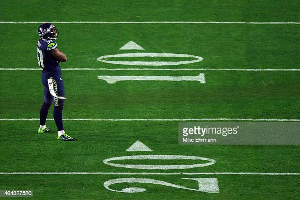outside linebacker Bruce Irvin of the Seattle Seahawks looks on against the New England Patriots during Super Bowl XLIX at University of Phoenix...