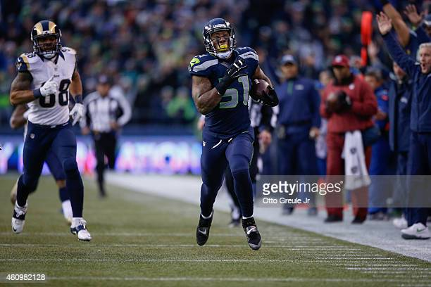 Outside linebacker Bruce Irvin of the Seattle Seahawks returns an interception for a touchdown during the fourth quarter of the game against the St...