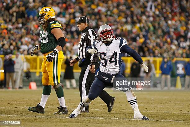 Outside linebacker Dont'a Hightower of the New England Patriots celebrates after sacking quarterback Aaron Rodgers of the Green Bay Packers in the...