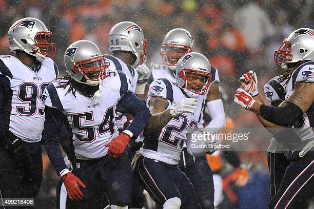 Outside linebacker Dont'a Hightower of the New England Patriots and strong safety Patrick Chung of the New England Patriots react to a play against...
