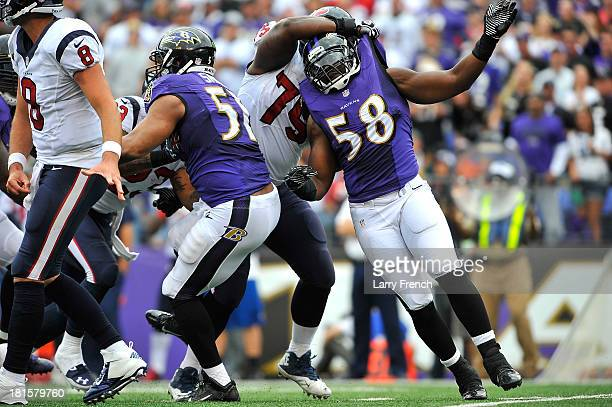 Outside linebacker Elvis Dumervil of the Baltimore Ravens is held as he rushes the Houston Texans quarterback penalty not called at MT Bank Stadium...