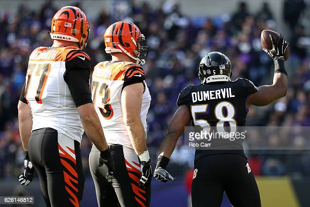 Outside linebacker Elvis Dumervil of the Baltimore Ravens reacts after recovering a fumble while tackle Andrew Whitworth and tackle Eric Winston of...